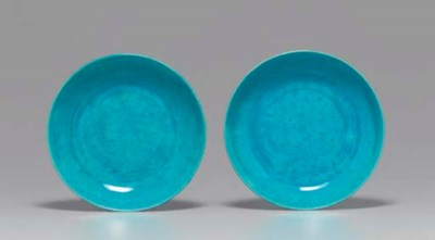 A PAIR OF TURQUOISE-GLAZED DIS