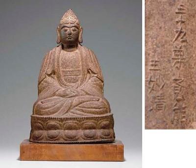 A CAST-IRON FIGURE OF BUDDHA