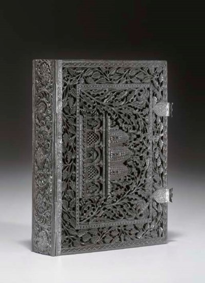 [CARVED WOODEN BINDING.] A pho