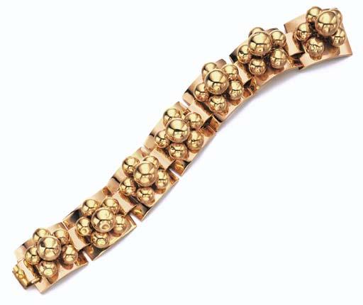A RETRO 18K GOLD BRACELET, BY