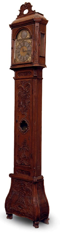 A CARVED OAK LONG CASE CLOCK