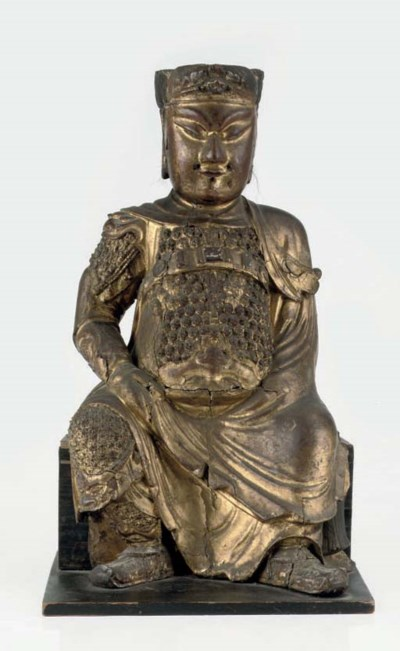A Chinese giltwood figure of G