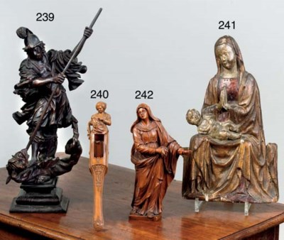 A CARVED LIMEWOOD GROUP OF ST