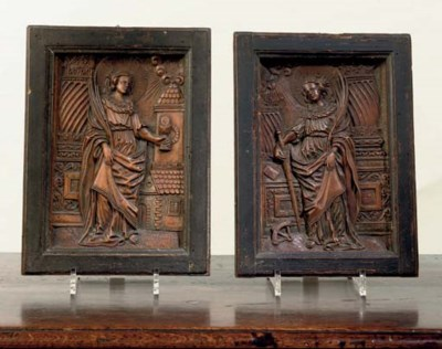 A PAIR OF RECTANGULAR CARVED L