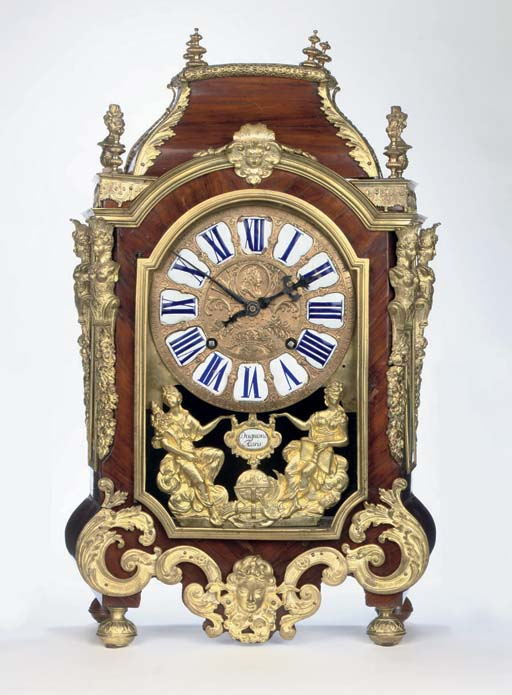 A LATE LOUIS XIV TULIPWOOD AND