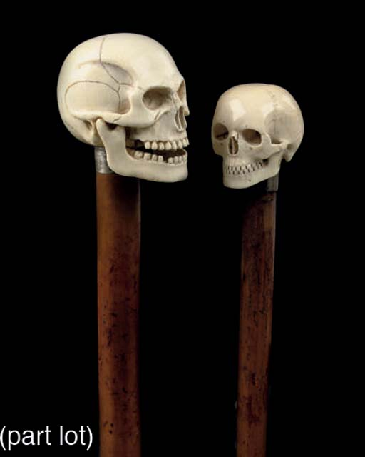 Four wooden canes with ivory s