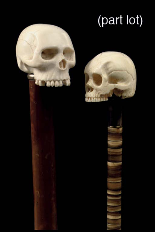 Four canes with ivory skull