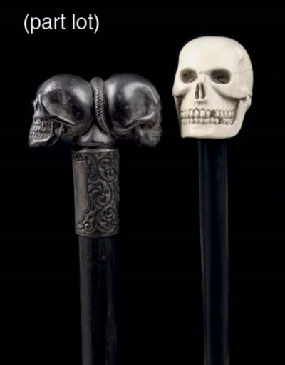 Four wooden canes with skulls