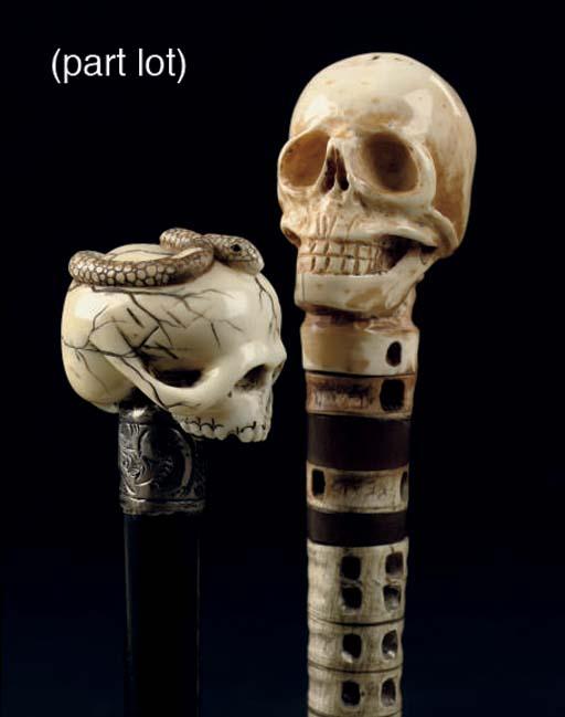 Four wooden canes with surmoun