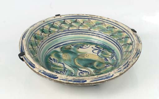 A Spanish pottery large basin