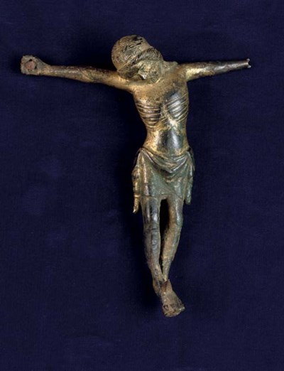 A GILT-BRONZE CORPUS FIGURE