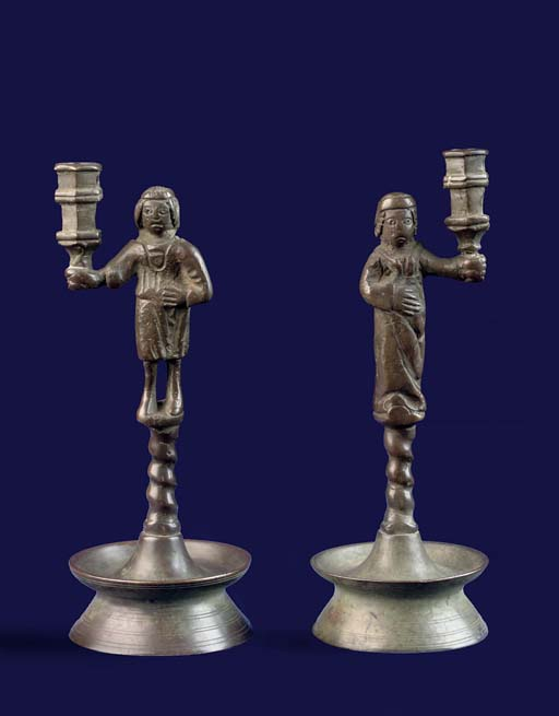 A PAIR OF BRASS FIGURAL CANDLE