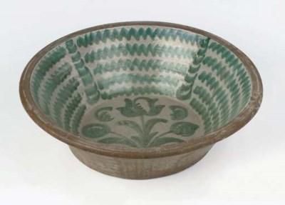 A Spanish pottery large basin
