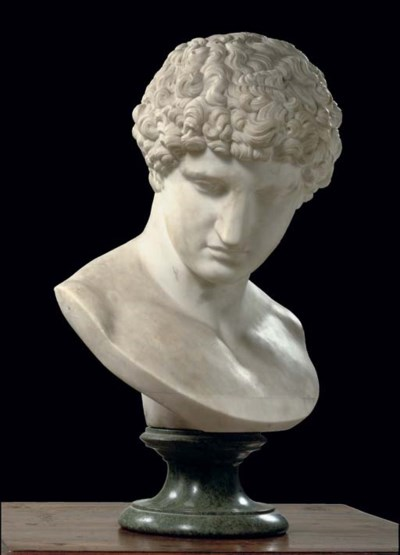 A WHITE MARBLE BUST OF THE CAP