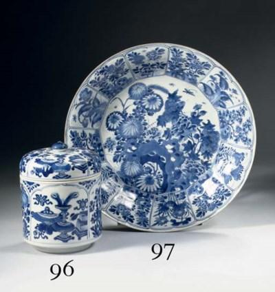 A blue and white U-shaped bowl
