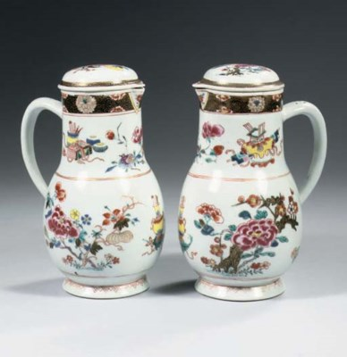A pair of famille rose jugs an