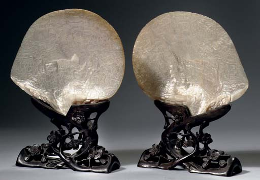 A pair of carved shells