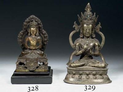 A Sino Tibetan bronze figure o