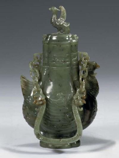 A mottled green jade vase and