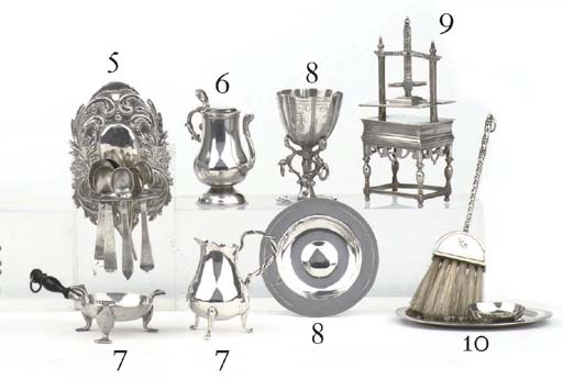 A Dutch silver miniature spoon rack with various spoons