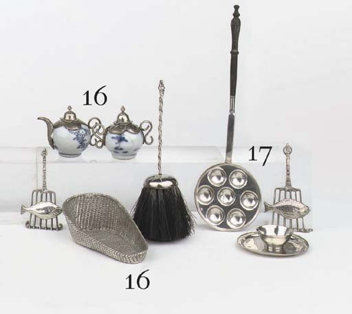 A Dutch silver miniature cradle, a fish grill, a blue and white Chinese porcelain, silver-mounted teapot with sugar-basin and a hearth-brush
