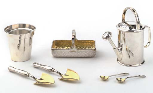 An amusing English silver 'garden' condiment set, in fitted case