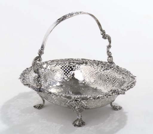 An english silver George II cake-basket