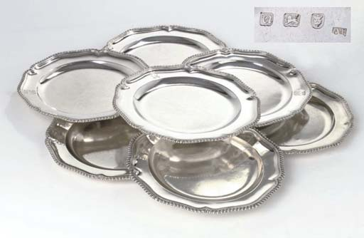 Seven english silver dinner-plates