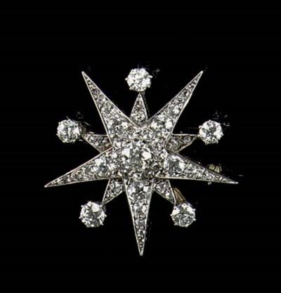 AN ANTIQUE DIAMOND STAR BROOCH