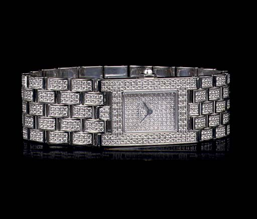 AN 18K WHITE GOLD AND DIAMOND WRISTWATCH, BY CHAUMET