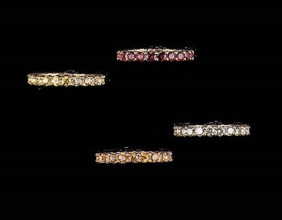 FOUR GEM-SET ETERNITY RINGS