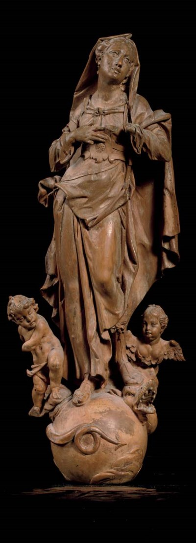 A CARVED LIMEWOOD FIGURE OF TH