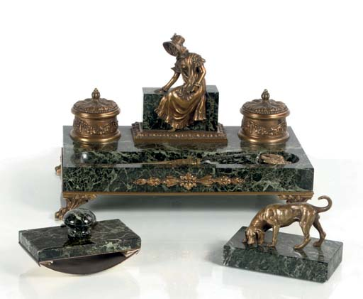 A FRENCH ORMOLU-MOUNTED VERDE ANTICO MARBLE INKSTAND WITH PAPER-KNIFE, BLOTTER AND PAPER-WEIGHT