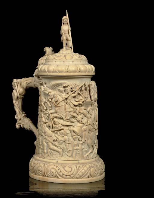 A RELIEF CARVED IVORY TANKARD