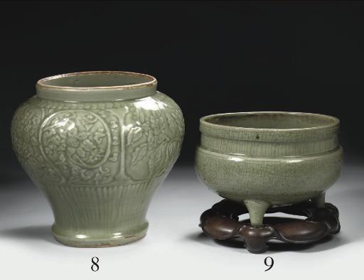 A celadon carved baluster jar