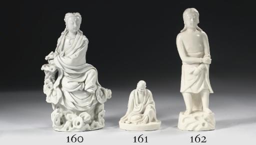 A blanc-de-Chine figure of a L
