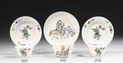 A pair of famille rose cups an