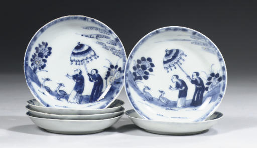 A set of six blue and white 'D