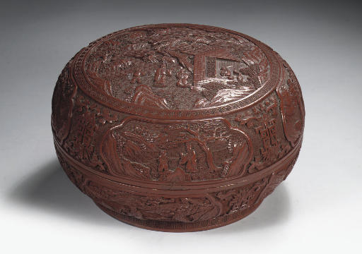 A red lacquer circular box and