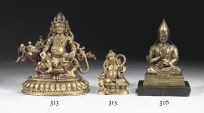 A Tibetan bronze figure of Jam