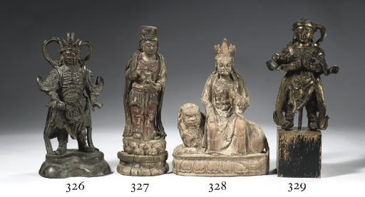 A Ming dynasty wood figure of