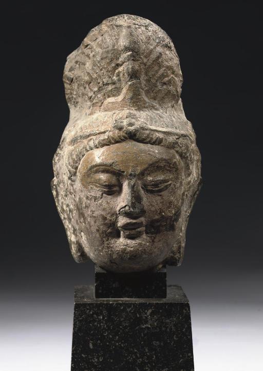 A GREY LIMESTONE HEAD OF A BOD