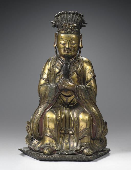 A Ming dynasty gilt-bronze fig