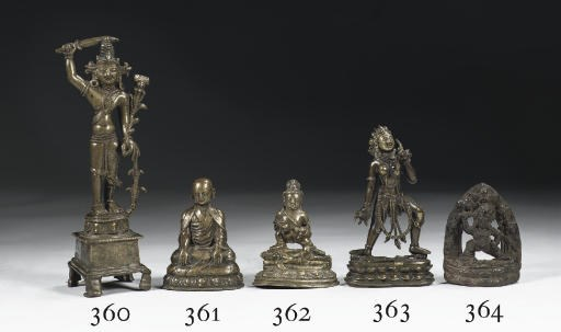 A Tibetan bronze figure of Bud