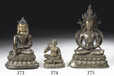 A Tibetan bronze figure of Bud