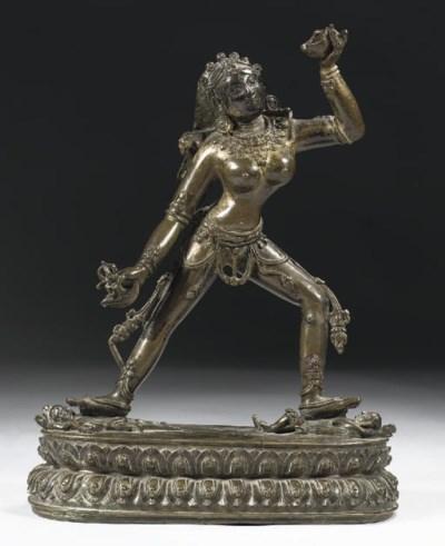 A Tibetan bronze figure of Sar