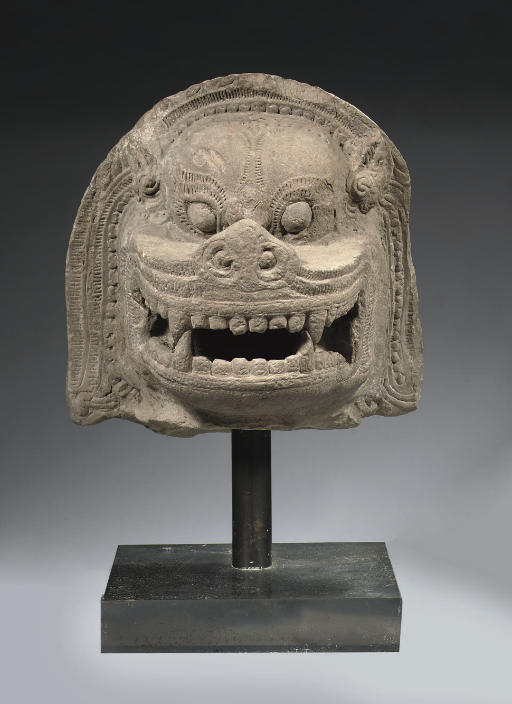 A Khmer, Angkor Vat style, sandstone head of a lion
