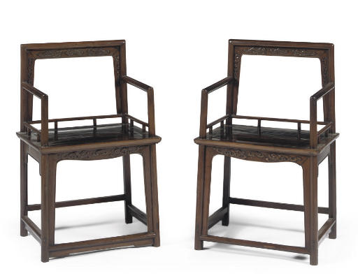 A pair of lacquered hardwood l