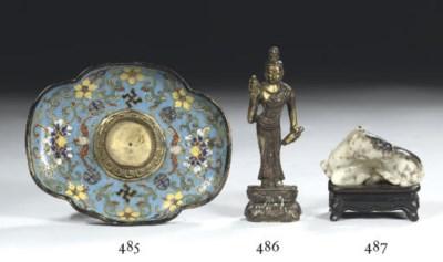 A small gilt-bronze figure of
