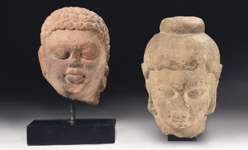 Two Indian sandstone heads